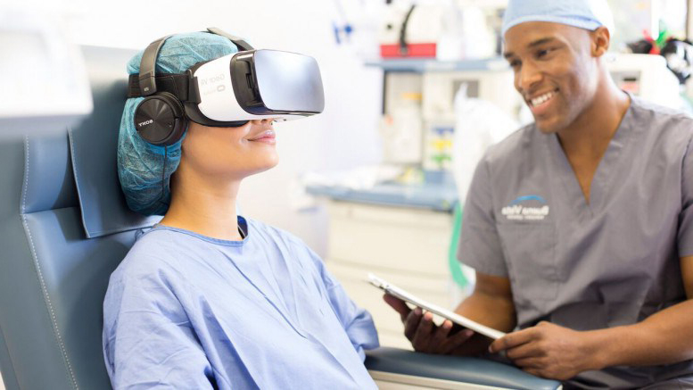Patient in hospital bed wearing VR headset